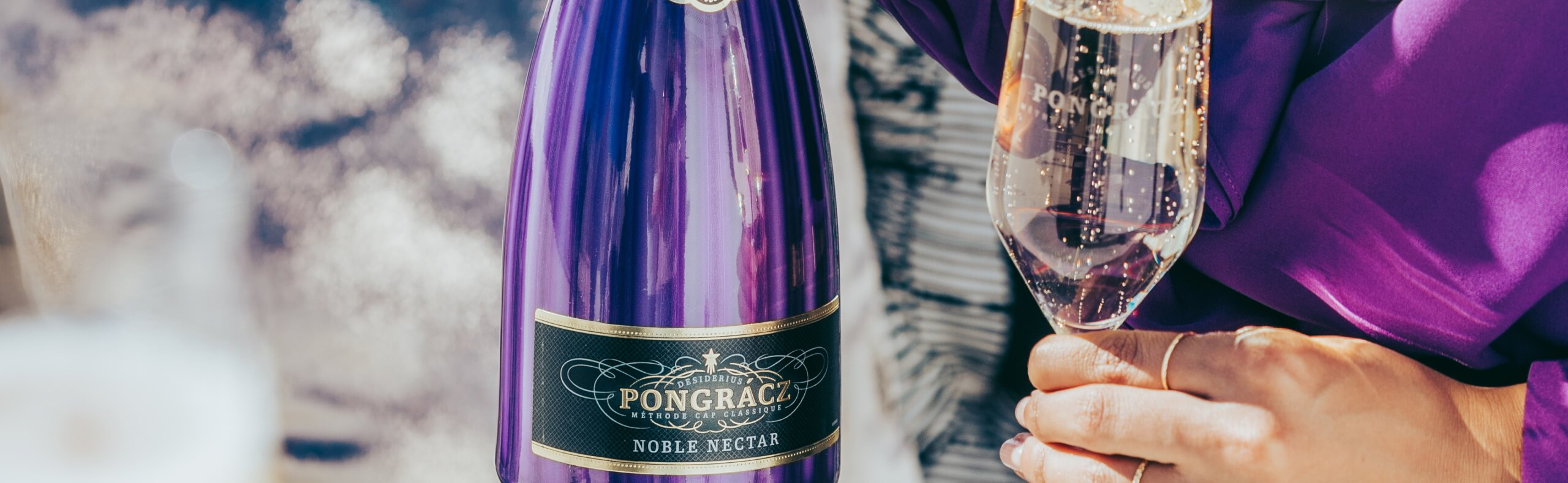 Pongracz Noble Nectar bottle with flute glass filled with MCC